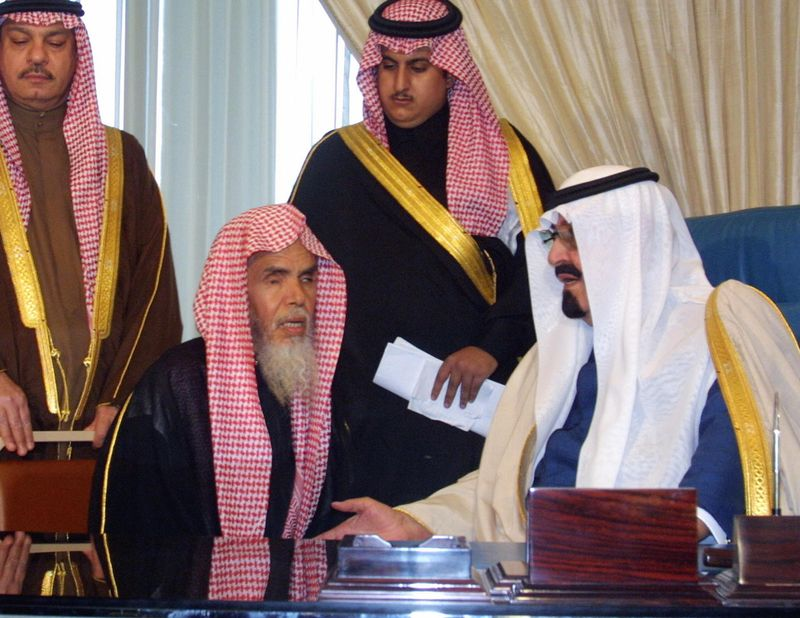 The late King Abdullah meets with an unidentified member of the religious police