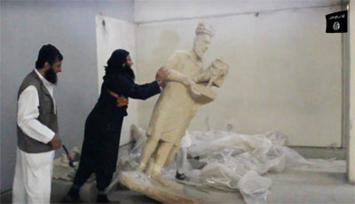 ISIS destroy ancient statues including king Hatra in the Mosul Museum collection
