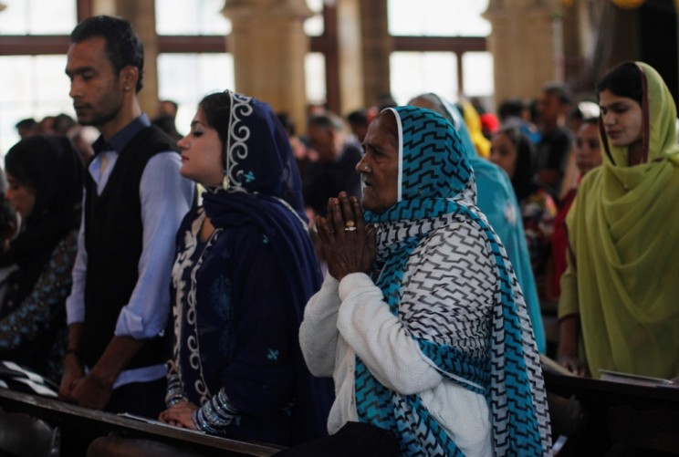 A Pakistani Christian woman attends mass along with others on Christmas day at St Andrew's Church in Karachi, December 25, 2013.
