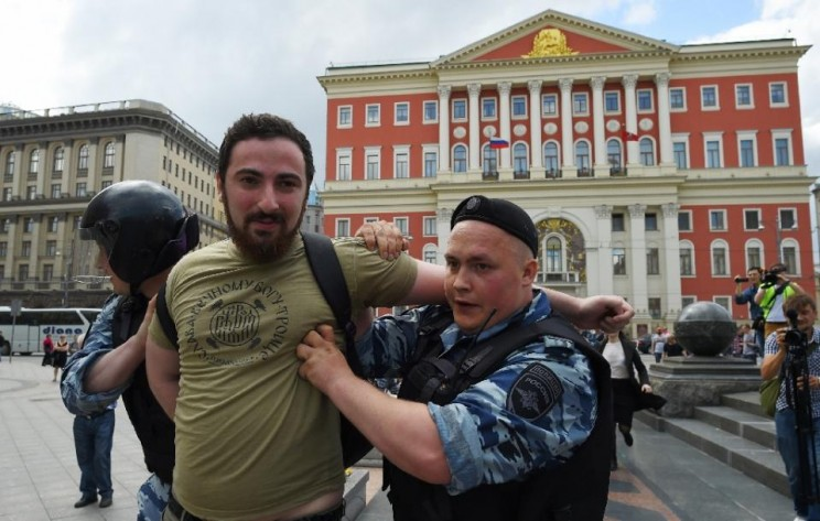"Orthodox activist Dmitry Enteo is ""delusional"" according to art centre. Here he is being led away by police."