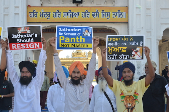 Sikh youth activists holding placards during a demonstration at Amritsar